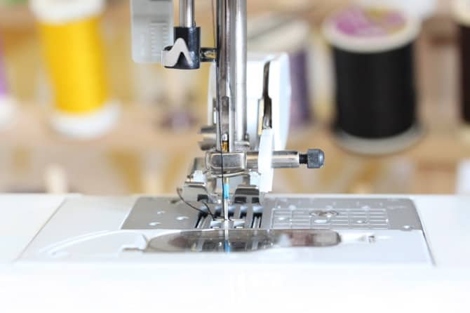 Image of a walking foot on a sewing machine