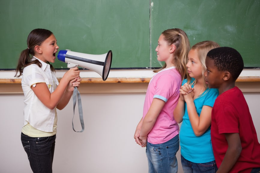 Angry schoolgirl screaming through a megaphone to her classmates